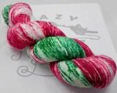 Jingle Bells: 438 yards 75/20/5 Superwash Merino/Nylon/Stellina fingering weight yarn in Luminosity yarn base.