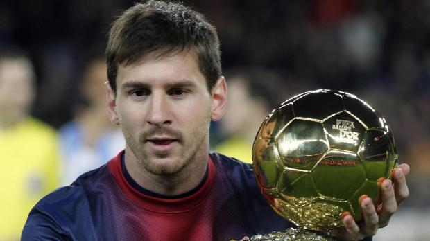 Barcelona's soccer player Lionel Messi shows his Ballon d'Or (Golden Ball) trophy to the crowd after winning the FIFA World Player of the Year 2012, before their Spanish King's Cup soccer match against Malaga at Nou Camp Stadium in Barcelona January 16, 2