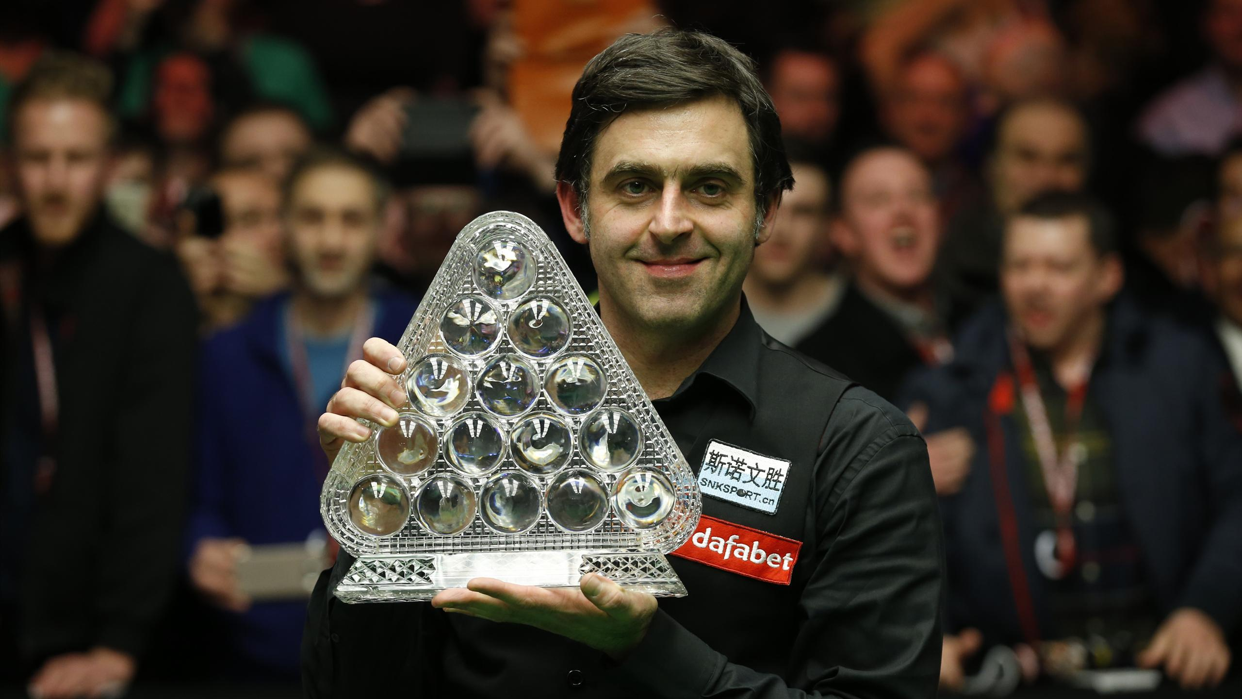 Ronnie O'Sullivan celebrates with the trophy after victory in the final