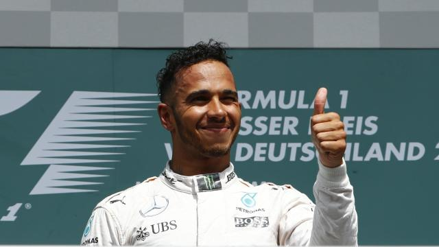 Lewis Hamilton gives a thumbs-up on the podium at the German GP