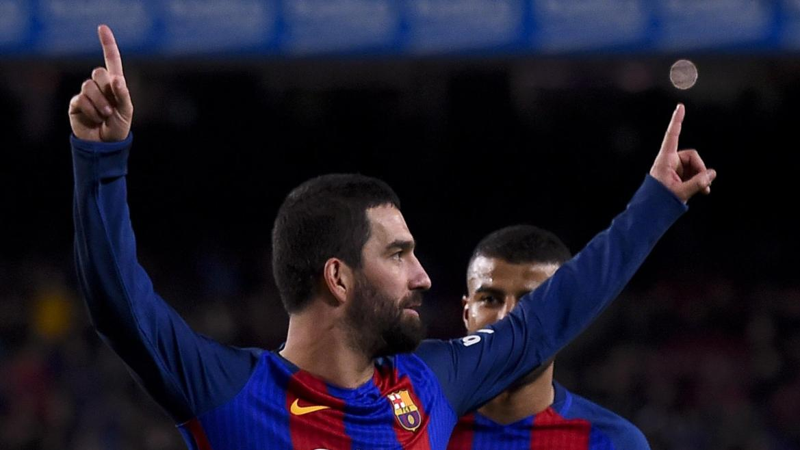 Barcelona's Turkish midfielder Arda Turan celebrates after scoring during the Spanish Copa del Rey (King's Cup) round of 32 second leg football match FC Barcelona vs Hercules CF at the Camp Nou stadium in Barcelona on December 21, 2016.