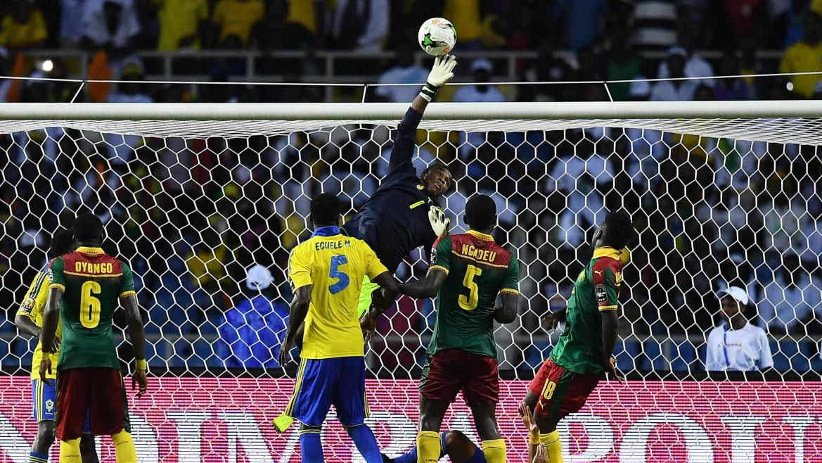 Cameroon's goalkeeper Fabrice Ondoa (C) blocks a shot on goal during the 2017 Africa Cup of Nations group A football match between Cameroon and Gabon at the Stade de l'Amitie Sino-Gabonaise in Libreville on January 22, 2017.