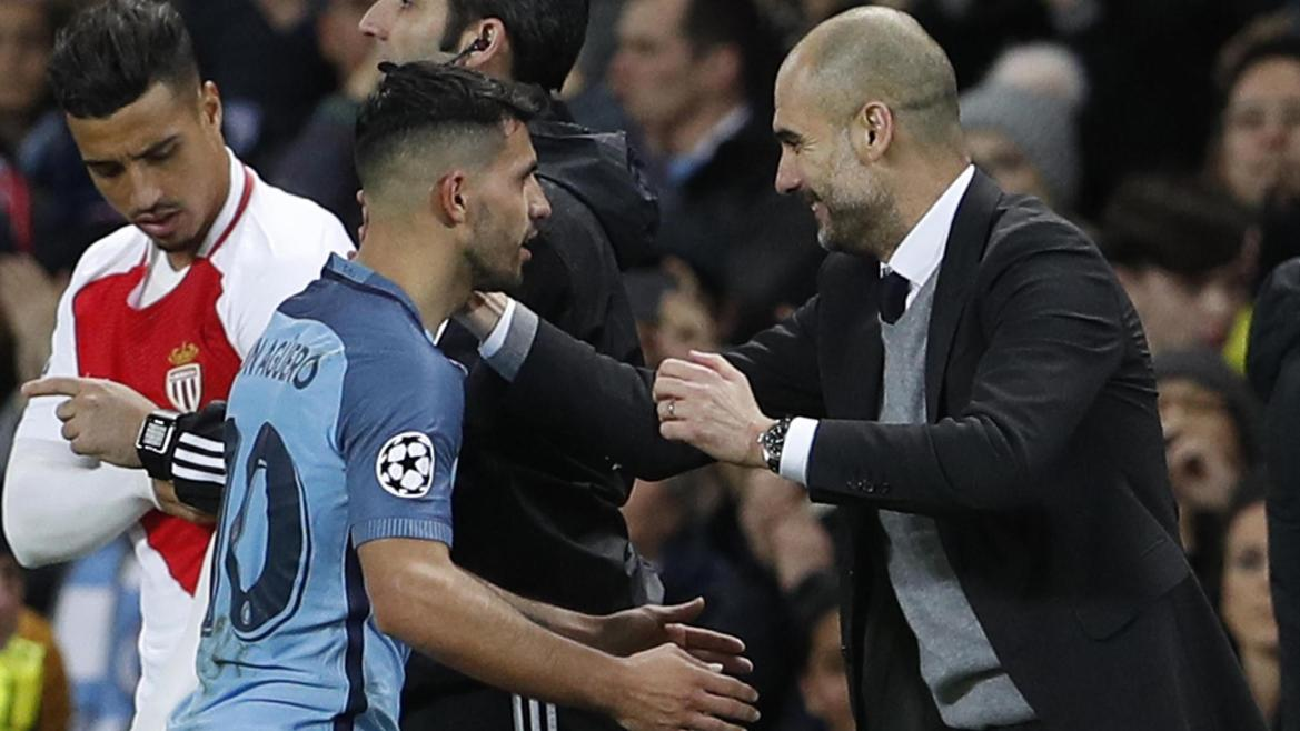 Manchester City's Sergio Aguero with Manchester City manager Pep Guardiola after being substitute.