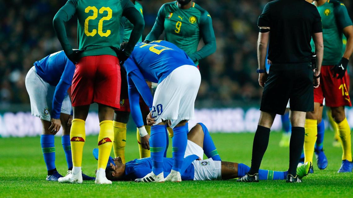 Brazil's Neymar down injured against Cameroon