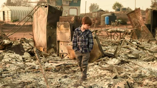 Jeremie Saylors, 11, in the ruins of Paradise.