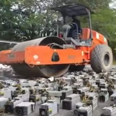 Watch: Steamroller Destroys Bitcoin Mining Rigs Worth Crores in Malaysia