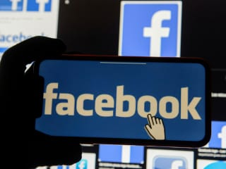 facebook logo on phone reuters small 1603788362267