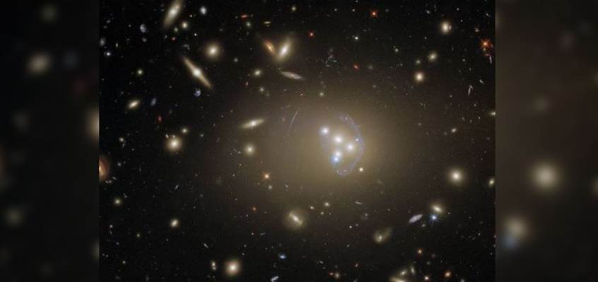 NASA Shares Stunning Photo of Galaxy Cluster Captured by Hubble Telescope