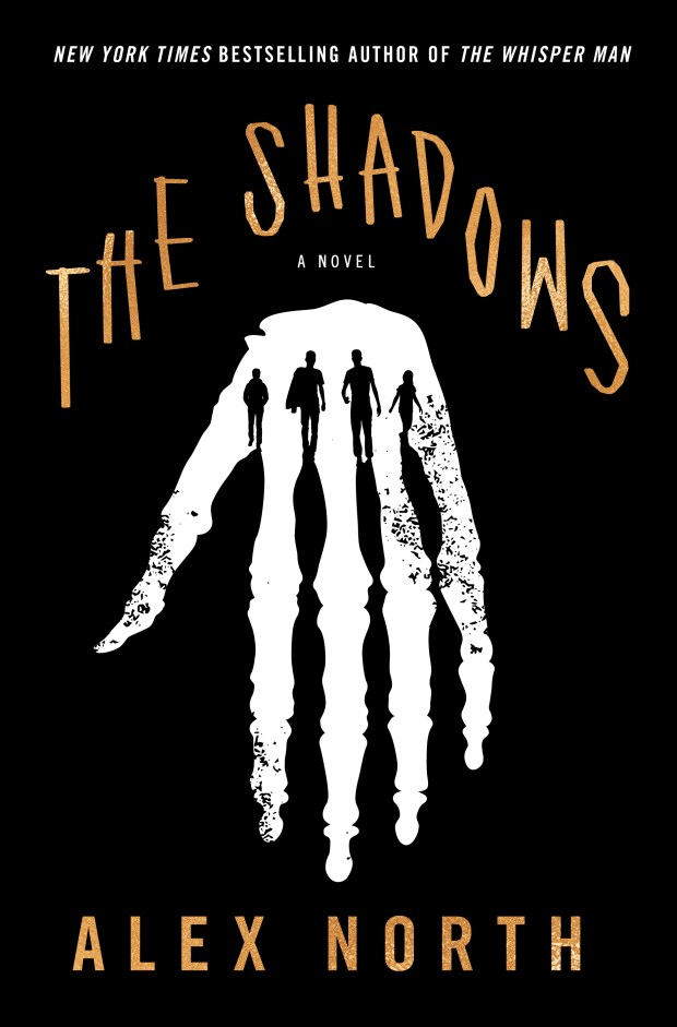 A white handprint is at the center, outlined with four children. 'The Shadows' and 'Alex North' is written brown text.
