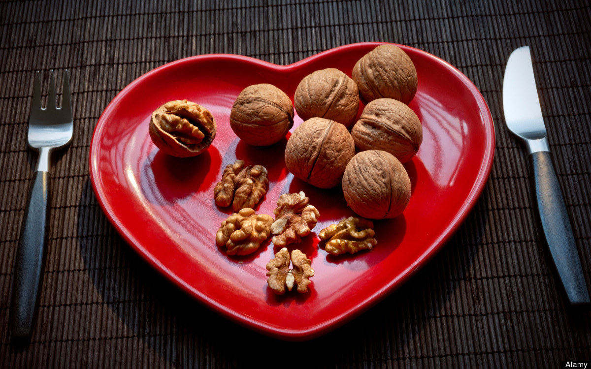 Image result for A handful of nuts can cut your heart disease and cancer risk