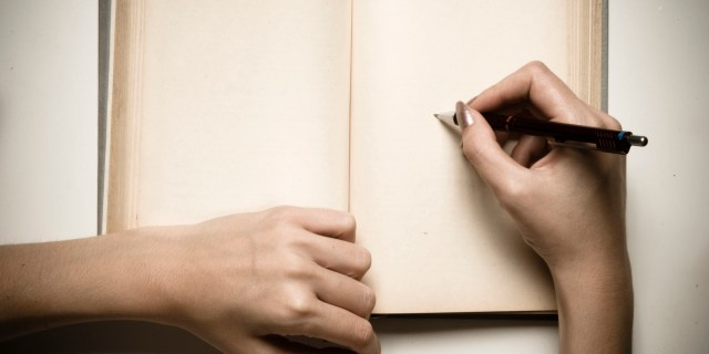 Image result for picture of a lady writing with a book and phone