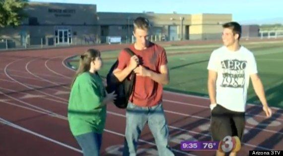 football team defends bullied girl