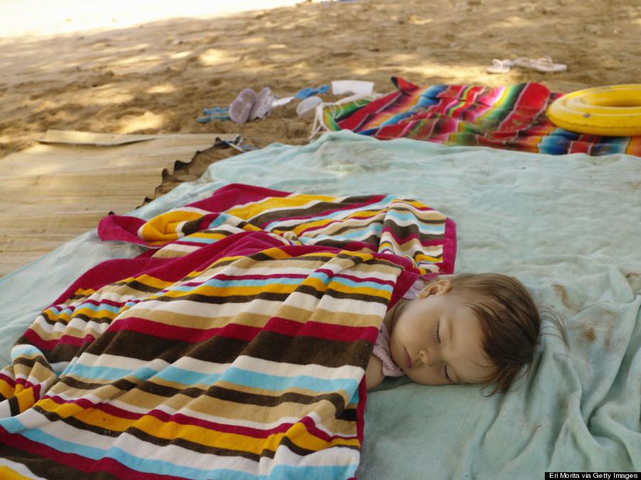 baby sleeping beach