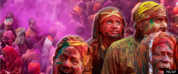 Coloured powder cakes Hindus celebrating Holi (photo from The Huffington Post)