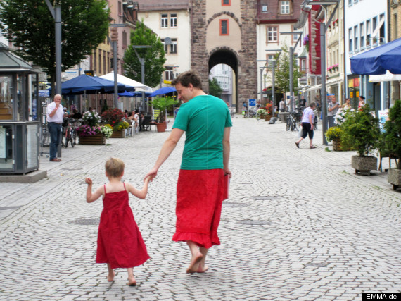 dad wears skirt with son