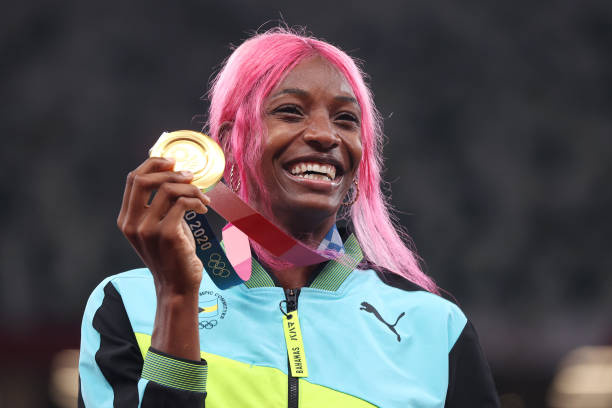 TOKYO-JAPAN-AUGUST-06-Gold-medalist-Shaunae-Miller-Uibo-of-Team-Bahamas-holds-up-her-medal-on-the-po