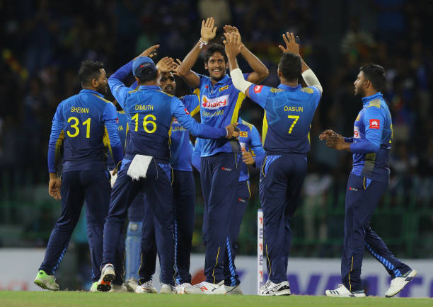Sri-Lankan-cricketer-Kasun-Rajitha-celebrates-after-taking-a-wicket-with-teamamtes-during-the-3rd-On