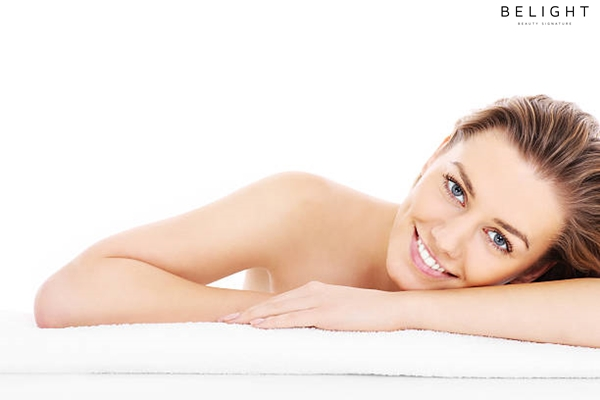 A-picture-of-a-young-woman-resting-her-head-on-a-towel-over-white-background