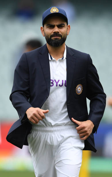 ADELAIDE-AUSTRALIA-DECEMBER-17-Virat-Kohli-of-India-after-the-toss-before-day-one-of-the-First-Test-