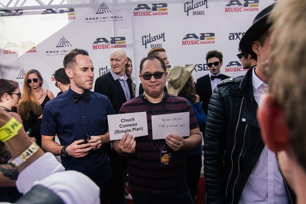 idobi CEO, Tom, leading our hosts Chuck and Brian down the red carpet
