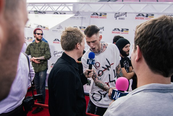 Machine Gun Kelly and Josh Madden catching up! Turns out they go way back... Josh used to babysit him.
