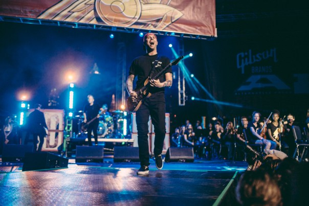 Kevin Skaff of A Day To Remember performing