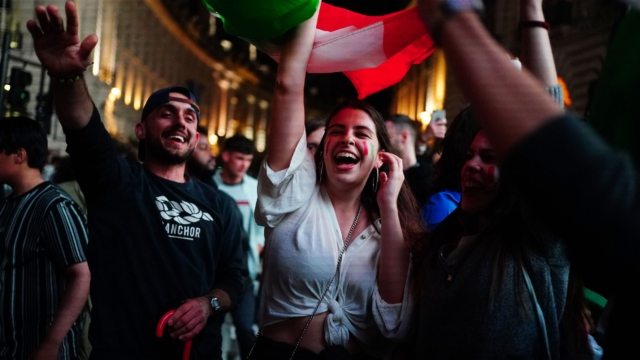 Italy fans celebrate in Piccadilly Circus in central London after their team won the UEFA Euro 2020 Final against England when the game was decided on penalties. Picture date: Sunday July 11, 2021. PA Photo. See PA story SPORT England. Photo credit should read: Victoria Jones/PA Wire.