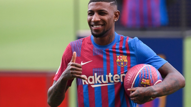 Barcelona's newly signed Brazilian defender Emerson Royal poses during his official presentation by the Spanish football club at the Camp Nou stadium in Barcelona on August 2, 2021. (Photo by Josep LAGO / AFP) (Photo by JOSEP LAGO/AFP via Getty Images)