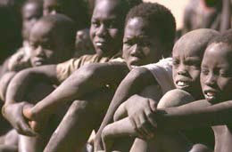 Sudanese slaves await redemption in Madhol, Sudan, in December 1997. An Arab trader sold 132 former slaves, women and children, for $13,200 (in Sudanese money) to a member of Christian Solidarity International. (AP Photo)