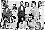 The Little Rock Nine pictured with Daisy Bates, the president of the Arkansas NAACP.