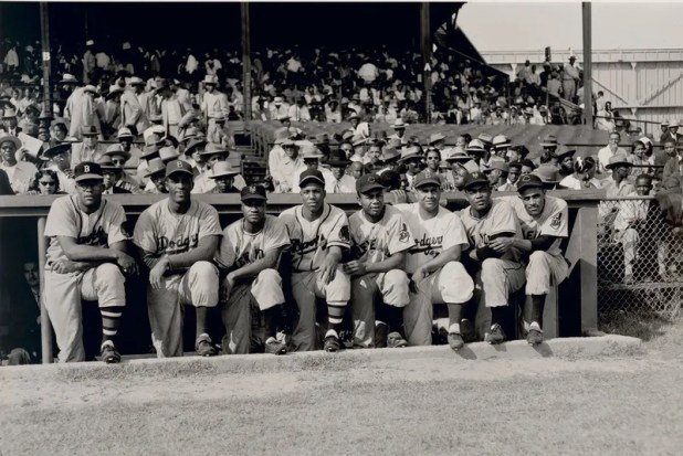 """Eight black MLB players photographed in a Black League All-Star Game in 1952. L-R: George Crowe, Joe Black, Hank Thompson, Sam Jethroe, Larry Doby, Roy Campanella, Mount Irvin and Harry """"Suitcase"""" Simpson."""