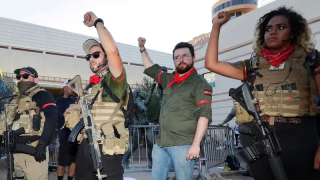 Members of the John Brown Gun Club and Redneck Revolt protest outside the Phoenix Convention Center on Aug. 22, 2017, in Phoenix. (Matt York/AP Images)