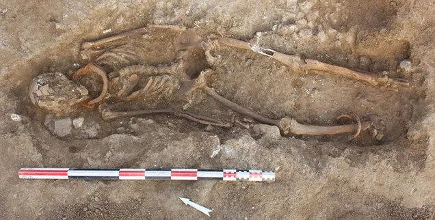 Skeletons Found In Ancient Cemetery Still Have Shackles On Their Necks