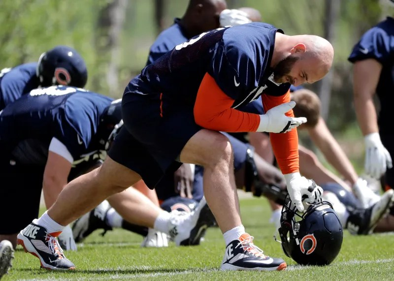Illustration for article titled Kyle Long Tried To Beat A Teammate With His Own Helmet And Then Barfed