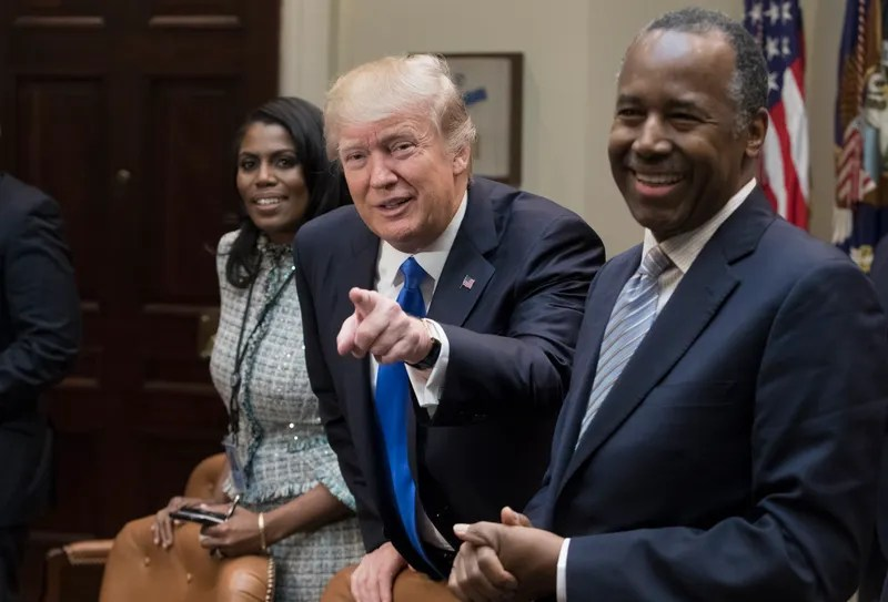 President Donald Trump holds an African-American History Month listening session attended by then-nominee to lead the Department of Housing and Urban Development Ben Carson (right), Director of Communications for the Office of Public Liaison Omarosa Manigault (left), among others, at the White House Feb. 1, 2017, in Washington, D.C. (Michael Reynolds-Pool/Getty Images)