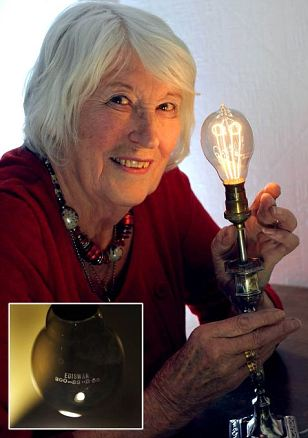 BETH CROOKS WITH HER 130 YEAR OLD WORKING LIGHT BULB WHICH IS BELIEVED TO BE THE OLDEST IN THE WORLD