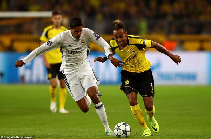 France and Real centre-backRaphael Varane (left) tries to keep pace with Dortmund's dangerman Aubameyang