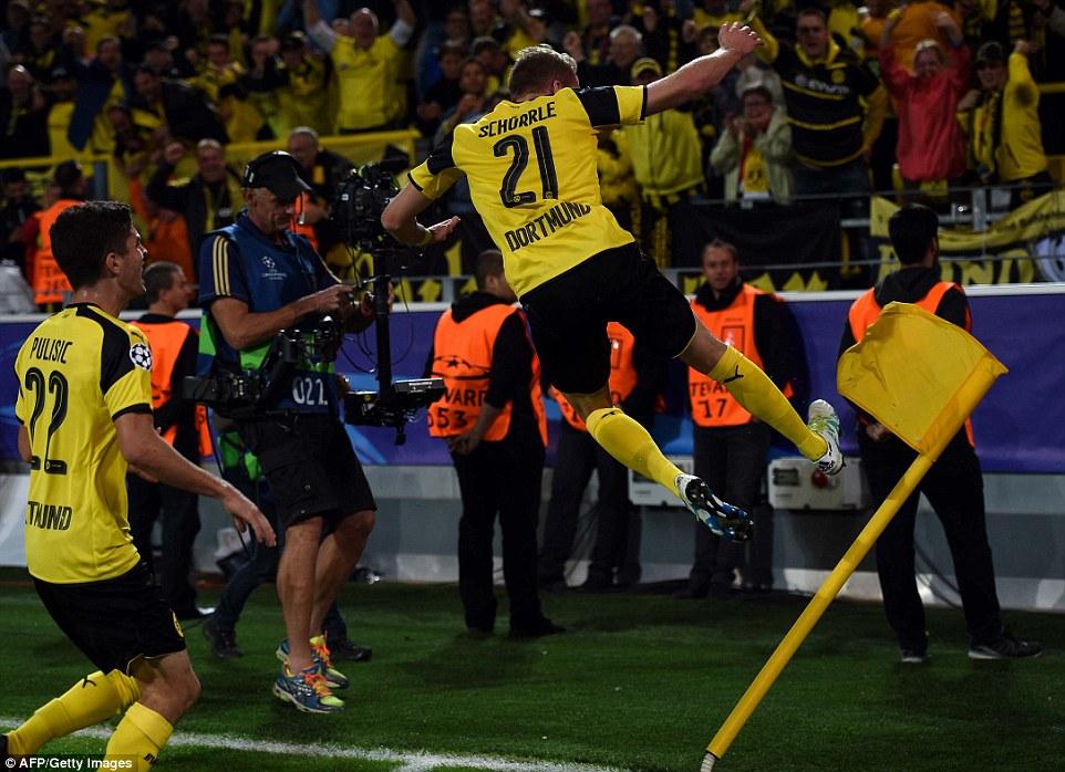 The former Chelsea forward kicks the corner flat amid scenes of jubilation at Signal Iduna Park