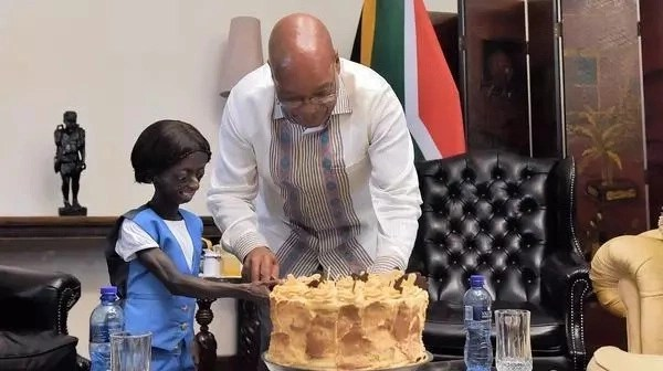Girl trapped in body of aging pensioner celebrates 18th birthday with President (photos, video)