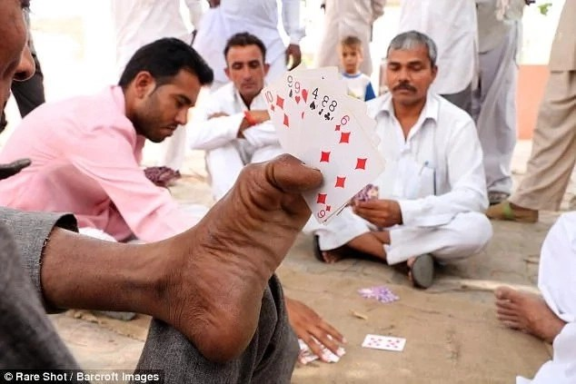 He also likes to play cards in his spare time. Photo: Barcroft Images