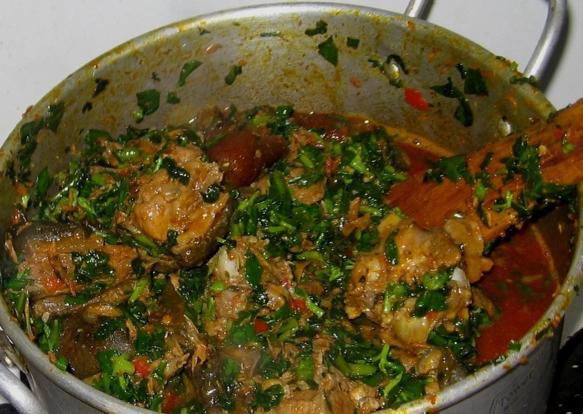 The Preparation Of Edikang Ikong Soup With Goat Meat And Oha Leaves