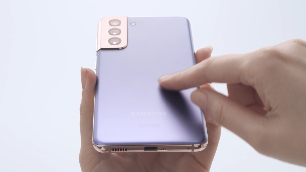 The back of the Samsung Galaxy S21 in a pale violet color, showing the single USB-C port on the bottom