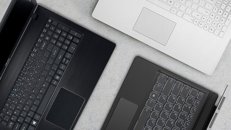 laptops open showing keyboards and touchpads