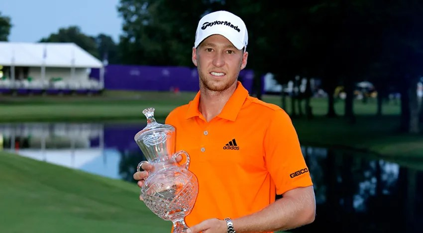 Daniel Berger celebrates with the trophy after winning the FedEx St. Jude Classic during the final round at TPC Southwind. (Andy Lyons/Getty Images)