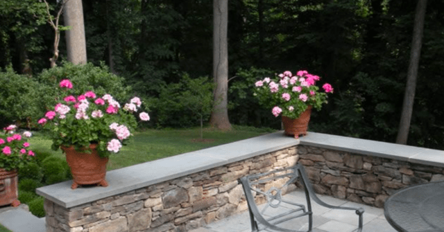 extending concrete patio in sloped yard