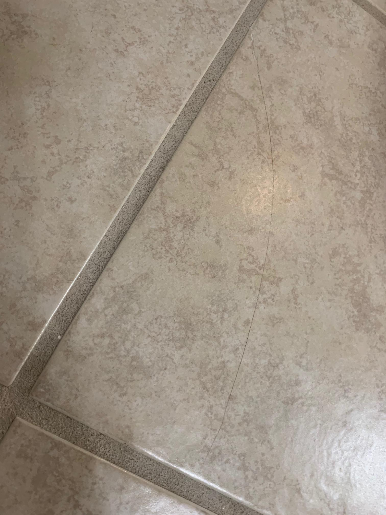 hairline crack in floor tile