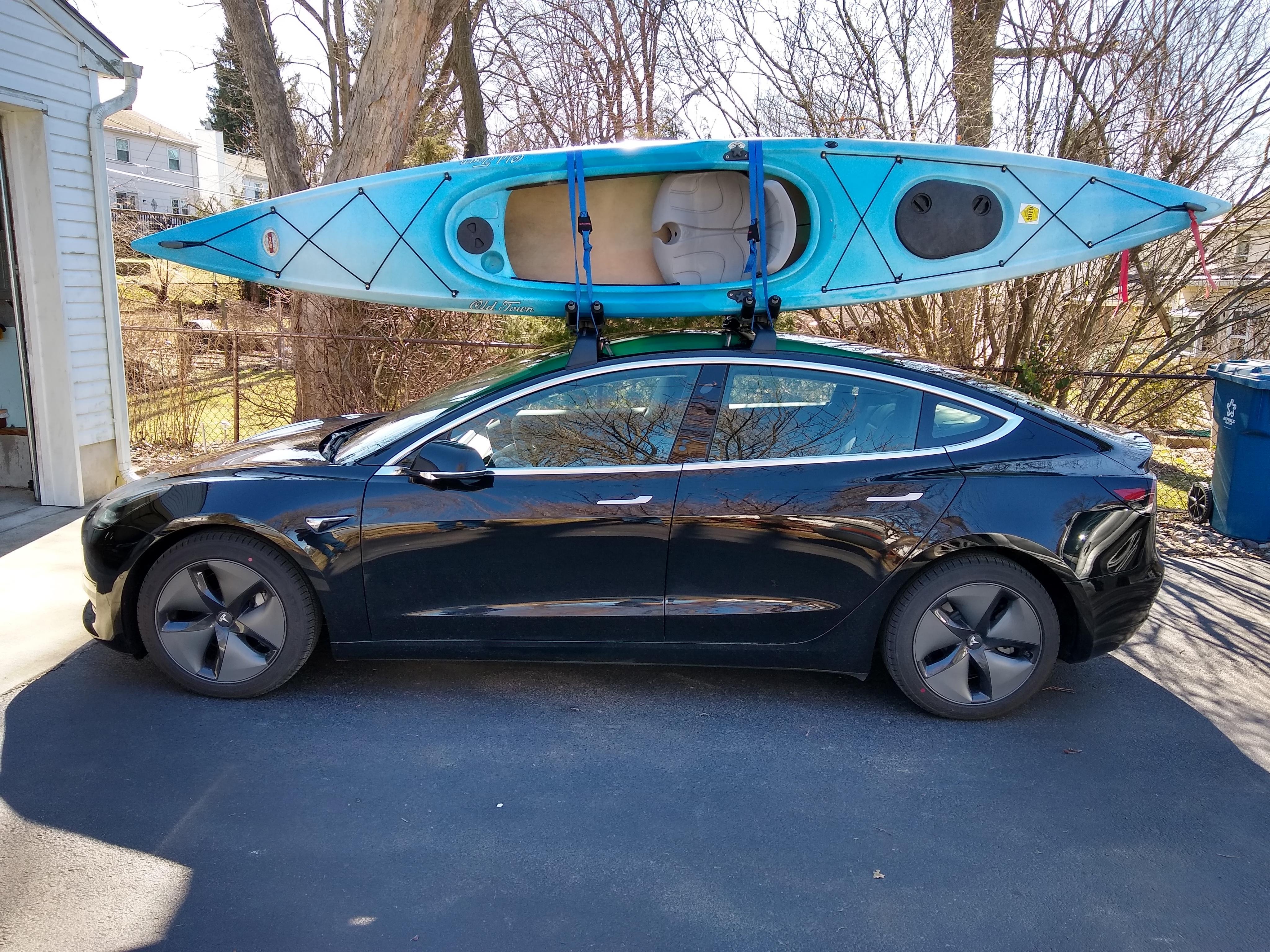 model 3 kayaks on factory roof rack