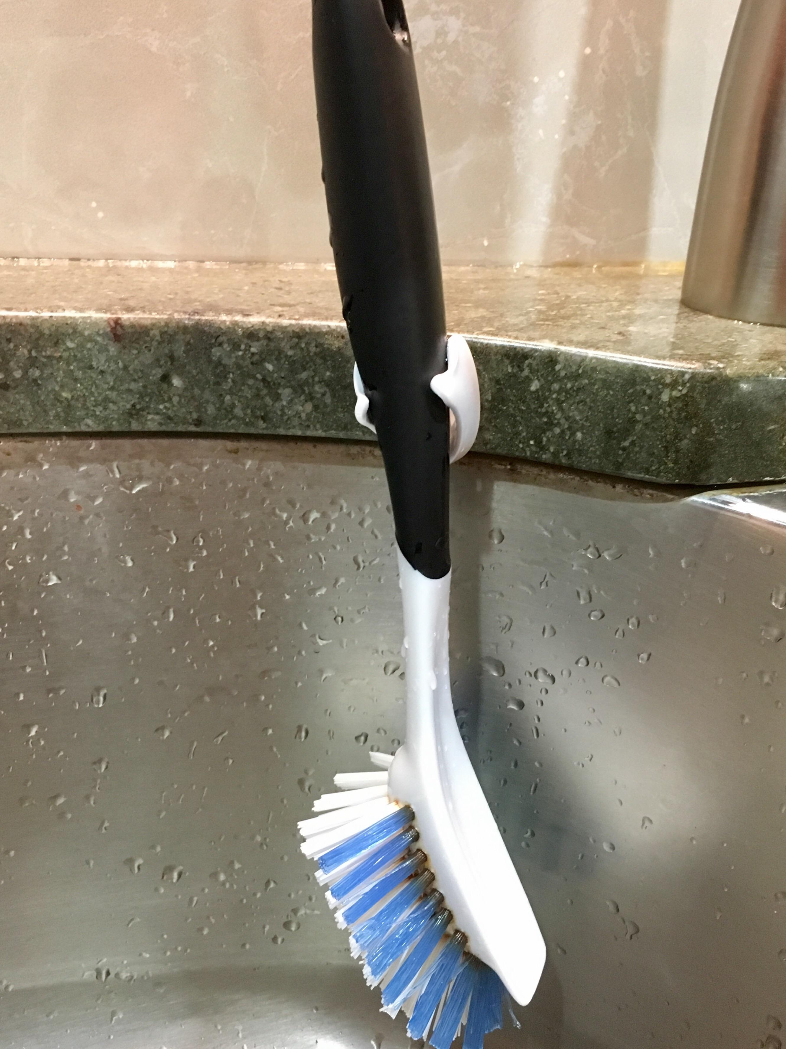 use a razor holder with suction cup to