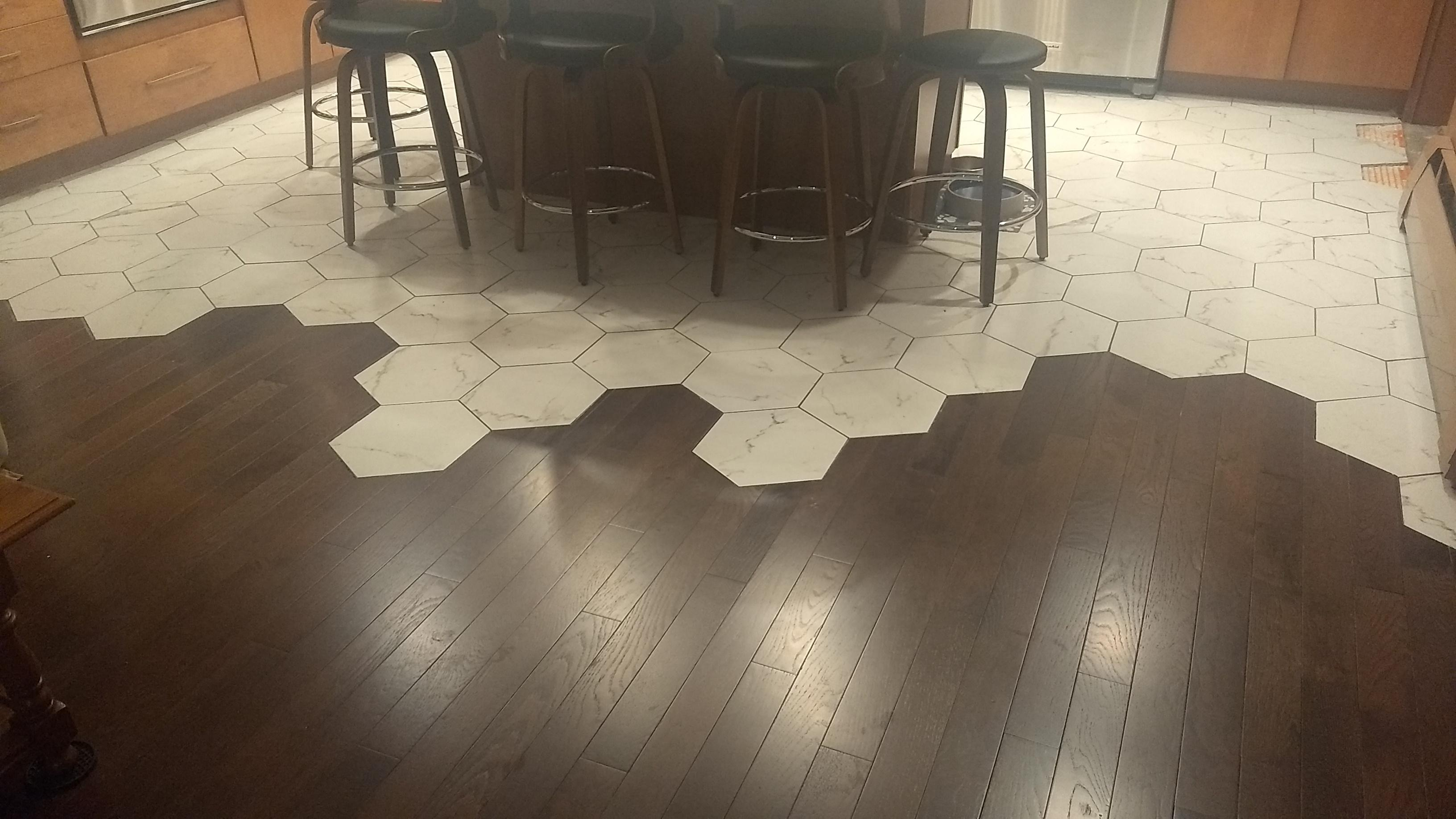 tile matches up perfectly with wood