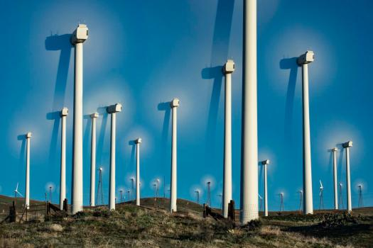 shadows of wind turbines in the wind